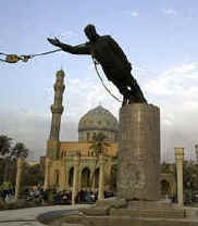 Saddam statue about to fall.